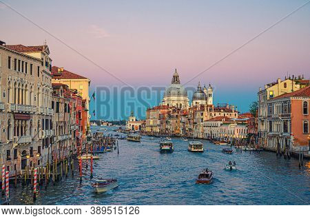 Venice Cityscape With Grand Canal Waterway. Buildings With Evening Lights Along Grand Canal. Santa M