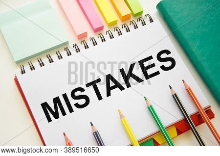 The Word Error Is Written On A White Piece Of Paper With Cardaches. Mistakes In Business And Educati
