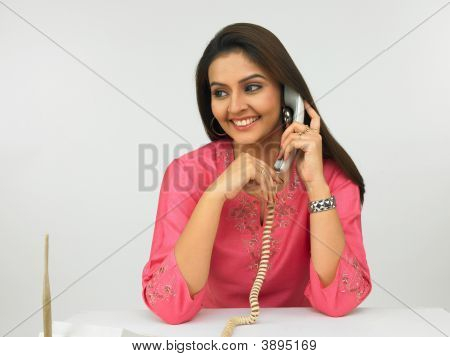 Asian Female Executive On The Phone