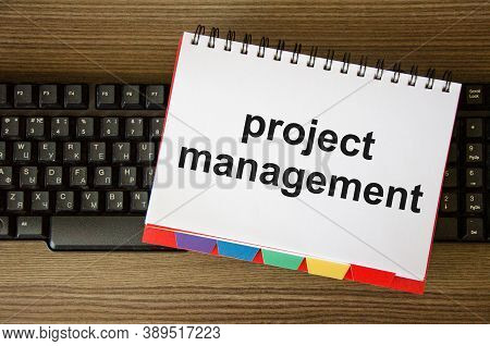 Project Management Team Update Schedule Or Scheduling On Computer, Business. The Word Project Manage