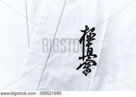 Kyokushinkai Karate Symbol On Cotton Background.