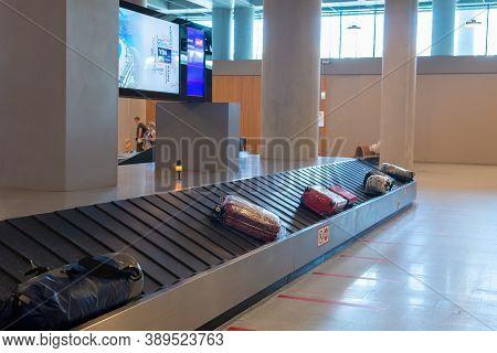 Dalaman, Turkey - October 11 2020: Yda Dalaman Havalimani Airport. Suitcase Or Luggage With Conveyor