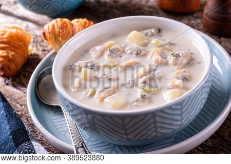 A Bowl Of Delicious New England Clam Chowder With Fresh Clams, Potato, Celery And Cream.