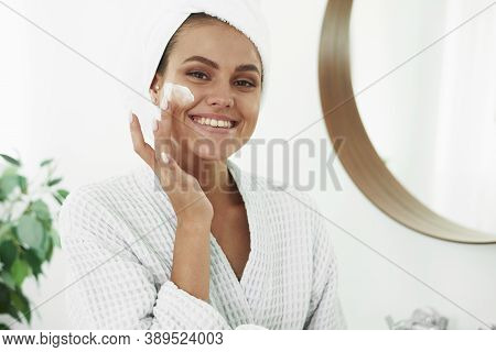 A Beautiful Young Woman With Vitiligo On Her Hands In A Bathrobe And With A Towel On Her Head Applie