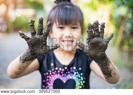 Kids Playing With Clay Muddy. This Activity Is Good For Sensory Experience And Learning By Touch The