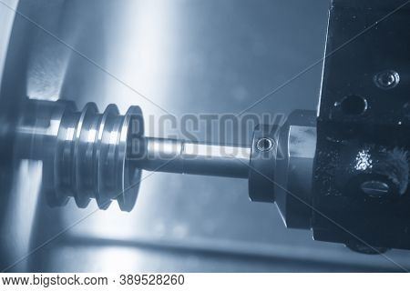 The  Cnc Lathe Machine Bore Cutting The Metal Pulley Parts. The Hi-technology Metal Working Processi