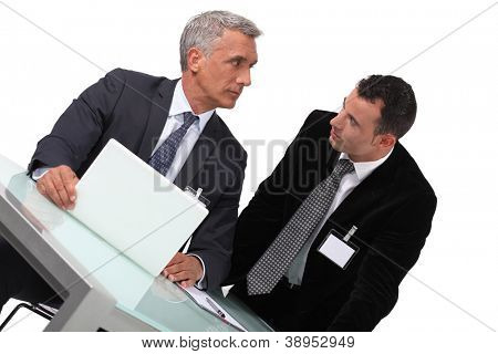 Two businessmen awaiting conference