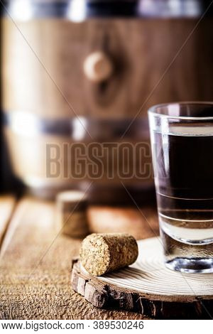 Small Glass Of Alcoholic Beverage, Distilled Drink Known As Cognac Or