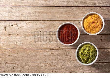 Traditional Mexican Sauces. Guacamole, Chilli Pepper Sauce And Cheese Sauce