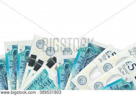 5 British Pounds Bills Lies On Bottom Side Of Screen Isolated On White Background With Copy Space. B