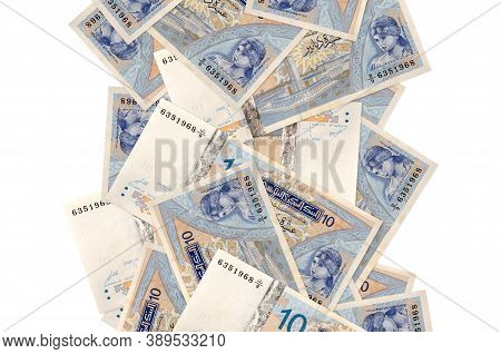 10 Tunisian Dinars Bills Flying Down Isolated On White. Many Banknotes Falling With White Copyspace