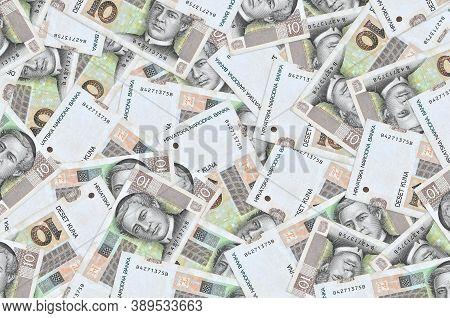 10 Croatian Kuna Bills Lies In Big Pile. Rich Life Conceptual Background