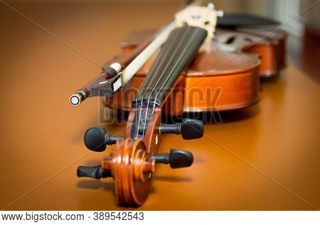Musical Instruments. Violin Close-up. Photo On A Wooden Table.