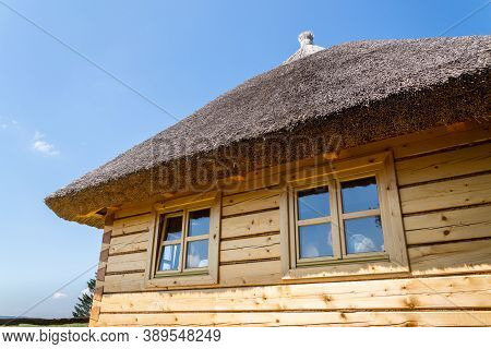 Detail Of Traditional Thatched Roof From Straw Or Reed On Sunny Summer Day