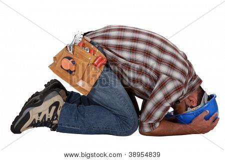 Tradesman with his head in his hands