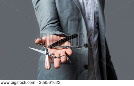 Man In A Suit Holds In His Hand A Vintage Razor And Scissors. Male In Barbershop. Barber Scissors An