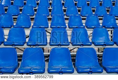 Stadium Seats Background. Rows Of Blue Plastic Empty Chairs