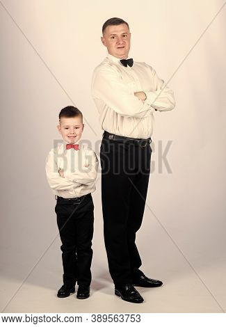 Little Son Following Fathers Example Of Noble Man. Gentleman Upbringing. Father And Son Formal Cloth