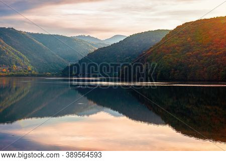 Gilau Lake Of Cluj Country In Evening Light. Beautiful Landscape Of Romania In Autumn. Reflection On