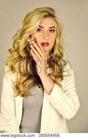 Female Fragrance Concept. Perfume Created For Daring Person. Attractive Woman Hold Perfume Bottle. F