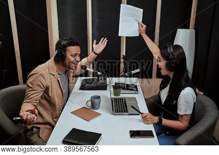 Portait Of Two Radio Hosts, Young Man And Woman Looking Emotional While Talking With Each Other, Mod