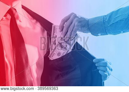 Businessman Or Politician Taking A Bribe In The Color Of Police Sirens. The Concept Of Arresting A P