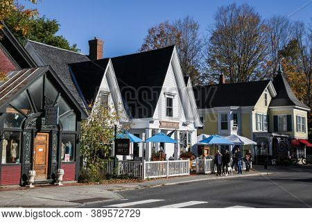 WOODSTOCK, VT, USA - OCTOBER 9, 2020: People waiting in line upfront Mont Vert Cafe during COVID-19 pandemic