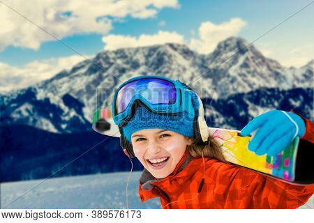 Ski in Zakopane, young girl on Groomed ski track under Giewont, Tatry, Poland.