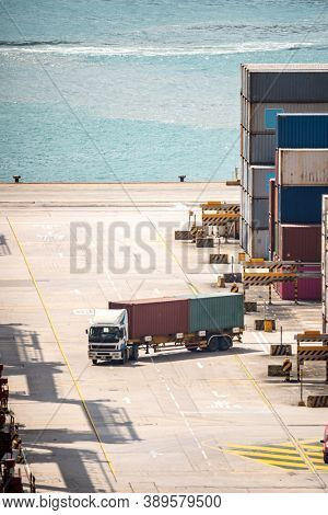 Working at Tsing yi Hong Kong Port for shipping and freight transportation with truck and boat for global business import and export background