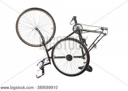 Black bicycle taken apart for fixing tyre, wheel taken off