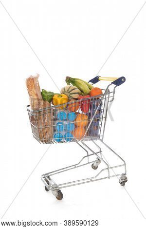 Shopping cart blue and yellow full with fresh groceries