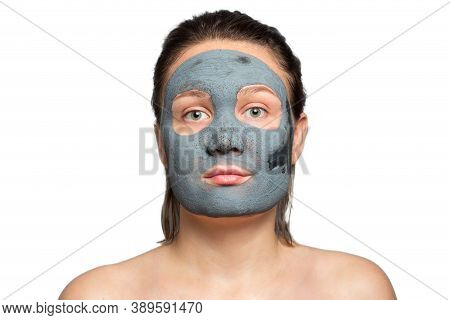 Caucasian Woman With A Clay Or A Mud Mask On Her Face Over White Background. Solving Acne Problems,