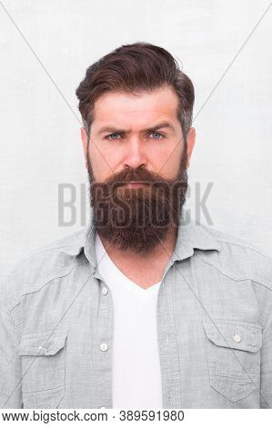 Well Groomed Macho. Hipster With Beard And Mustache Wear Denim Shirt. Brutal Handsome Hipster Man On
