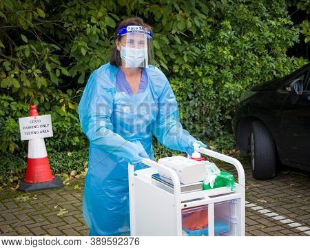 Harpenden, Uk - October 05, 2020. Nurse Wearing Full Ppe (personal Protective Equipment) At A Corona