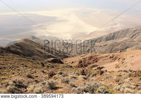Arid Mountain Range On A Barren Windswept Ridge Overlooking The Salt Flats On Badwater Dry Lakebed T
