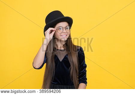 Falling In Love With My Eyewear. Happy Child Wear Glasses Yellow Background. Fashion Eyewear. Childs