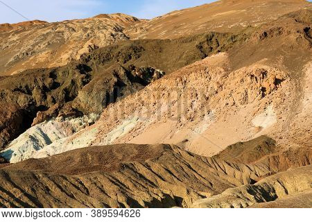 Arid Badlands With Eroded Colorful Hills Representing Mineral Deposits On A Barren Canyon Taken At T