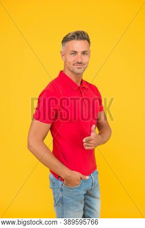 Happy Man With Stylish Beard Hair In Casual Fashion Style Pointing Gun Hand Gesture Yellow Backgroun