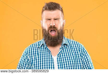 Man Bearded Hipster With Sneezing Face Closed Eyes Close Up Yellow Background. Brutal Hipster Sneezi