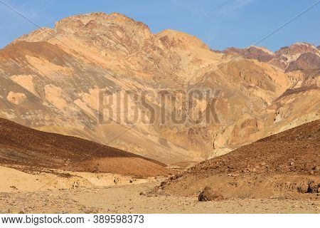 Arid Plateau Besides Barren Mountains Taken At The Rural Mojave Desert In Death Valley National Park