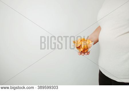 Processed Food, Unhealthy Diet, Imbalanced Ration. Overweight Woman Eating Salted Fattening Potato C