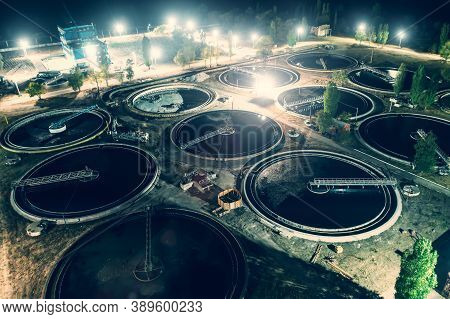 Treatment Plant With Tanks For Purification And Filtration Of Urban Waste Water, Aerial View At Nigh