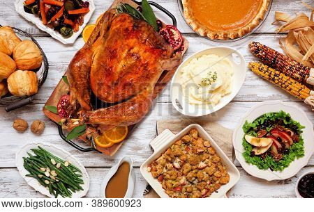 Traditional Thanksgiving Turkey Dinner. Top View Table Scene On A Rustic White Wood Background. Turk