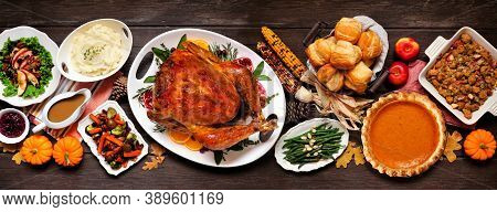Traditional Thanksgiving Turkey Dinner. Top View Table Scene On A Dark Wood Banner Background. Turke