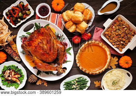 Classic Thanksgiving Turkey Dinner. Above View Table Scene On A Dark Wood Background. Turkey, Mashed