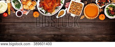 Traditional Thanksgiving Turkey Dinner. Above View Top Border On A Dark Wood Banner Background With