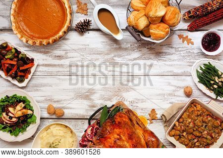 Classic Thanksgiving Turkey Dinner. Top Down View Frame On A Rustic White Wood Background With Copy