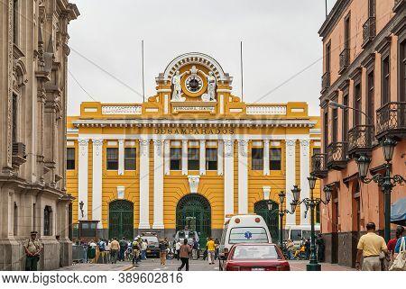 Lima, Peru - December 4, 2008: Yellow And White Historic Desamparados Railway Station Under Silver S
