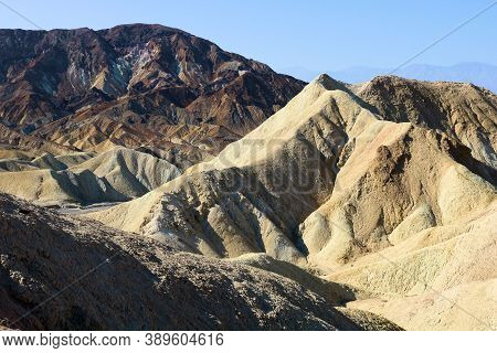 Canyon With Natural Shadows During Sunrise Surrounded By Barren Eroded Hills Taken At Zabriskie Poin