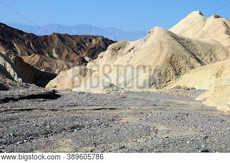 Dry Riverbed Surrounded By Arid Eroded Hills Taken At An Arid Canyon Taken At The Mojave Desert In D